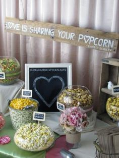 Love is sharing your popcorn - wedding popcorn bar. www.specialeventsinstitute thinks what's not to love?