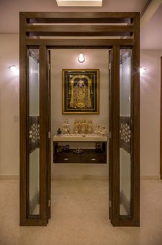 Here are some latest pooja room designs form different parts of India. You can pick some great ideas and create a soulful interior for your pooja room. Latest Door Designs, Cabinet Door Makeover, Temple Room, Temple Design For Home, Wooden Glass Door, Mandir Design, Living Room Partition, Pooja Room Door Design, Bedroom False Ceiling Design