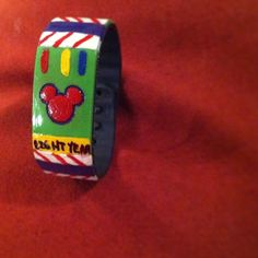 got our disney magic bands in! I painted our sons a Buzz Lightyear magic band. custom magic band