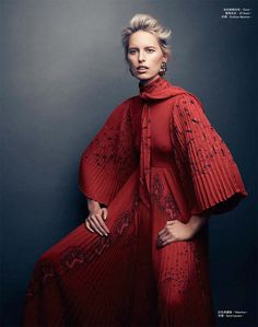 Wearing red, Karolina Kurkova poses in Valentino dress and Saint Laurent earrings