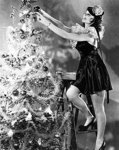 Rita Hayworth trims her tree. Circa 1940