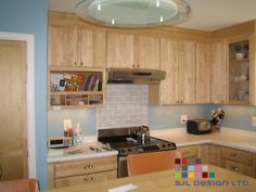 These Clean Maple Cabinets Provide A Sleek Modern Look In This L Shaped  Kitchen Paired