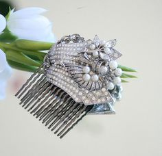 """I created this lovely wedding hair comb using 4 vintage jewelry pieces from the '50's and '60's. The brilliant vintage rhinestones and white beads bring to mind the art deco period. All are mounted on 2 vintage style silver filigree pieces with a new lead free hair comb.    """"The perfect way to wear something old and something new""""     * The hair comb is just 2 inches wide or 50mm  * 2 inches tall, not including the comb.   * Weighs 2 oz      See my other hair ornaments by clicking on this…"""