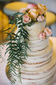 semi-naked buttercream layer cake with rose topper
