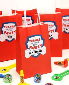 Make your own Paw Patrol party bags with plain red paper bags and our free printable labels. Download them for free at partydelights.co.uk.