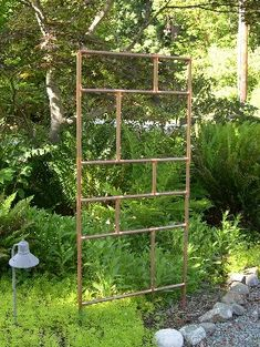 Garden trellis made with copper pipes