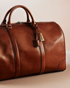 men's travel accessories at Coach