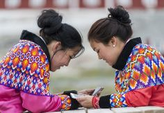 Two young Greenlandic women in national costume
