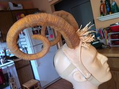 Headpiece Ram Horns. Faux leather and sculpted yarn over foam board.