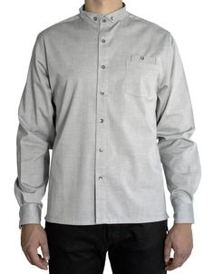 Grey button-up shirt. Smooth and thin cotton fabric, metal buttons, loose fit.