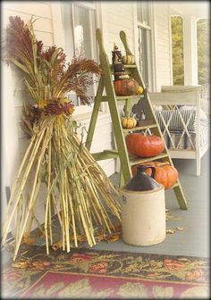 I like the ladder.  wonder what the chickens would do to the corn stalk on the porch??