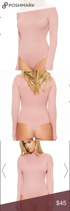 Naked Wardrobe turtle neck long sleeve bodysuit New with tags attached Celebrity favorite brand Naked Wardrobe light dusty pink ribbed long sleeve turtle neck bodysuit with snap enclosure at bottom in size small. Still in original packaging. Naked Wardrobe developed a cult following after Jennifer Lopez, the famous Kardashian, and Jenner family started gushing about the comfort and fit. Once you try your first NW piece you will understand why! Get the same brand as your favorite celebrities…