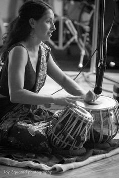 tabla one drum is wood and the other is metal