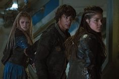 Still of Eliza Taylor, Bob Morley and Marie Avgeropoulos in The 100 (2014)