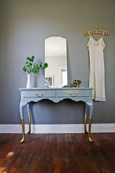 A-Z Home Decor Trend 2014: Gold with Alice T. Chan | San Francisco Bay Area Interior Renovation and Design Specialist. Here are some ways you can incorporate this 'it' trend into your own home...gold dipped furnishings like this gold dipped console table.