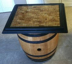 Wine cork table top made from old picture frame, a piece of plywood cut to fit back of frame, wine corks from drinking a little glue and epoxy resin mix.
