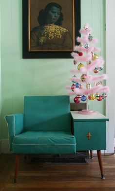 only wish I had the vintage telephone chair, but this year I did have a tabletop tree with vintage ornaments, only my tree was silver tinsel instead of pink feather...feather trees are hard to find.  And a silver tinsel tree can be found for 4 bucks at goodwill...