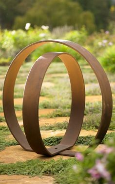 Put an inspired finishing touch on your garden space with a work of adaptable art, using our sleek Orb Garden Sculpture.