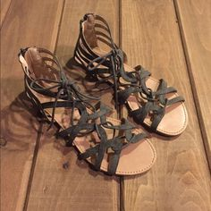 Gray gladiator sandals LIKE NEW gray sandals! Wore them one time! Super comfortable and cute!! Purchased at PacSun last summer! Can fit any size foot (wide or small) since it laces up! PacSun Shoes Sandals