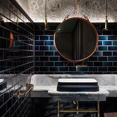Powder room House of Beast @house_of_beast Photo Dennis Lo #bathroom #instabathroom #mirror #gubi @gubiofficial #tiles #tiling #subwaytiles #wallpaper #adnetmirror #powderroom #brass #brassdetails #light #brasslight #basin #omvivo #houseofbeast #