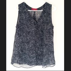 Great work shirt! Light, flowy, professional top. Sleeveless. 100% polyester.  Black, gray and white design. RED Saks Fifth Avenue  Tops