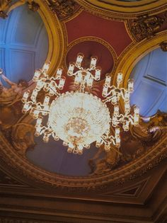 Beautiful ceiling and chandelier at The Queen's Theatre, London 2012.