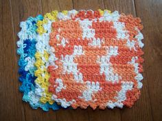 Crochet dish rags made from Peaches & Cream or Sugars & Cream cotton yarn. Chain 22, double crochet 9 rows, picot stitch edging. With size G hook makes it 7x7.