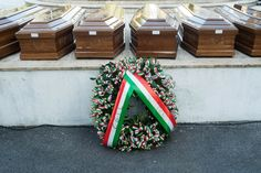 It held at Salerno's Monumental Cemetery on Friday morning, with local politicians, rescue workers and journalists in attendance.  Prayers were said by a Catholic archbishop and a Muslim imam.