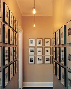 Bill's black-and-white photographs hang in a hallway joining the bedrooms. The pictures chronicle the family's history with candid charm.