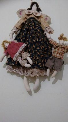 Boneca com anjinhos