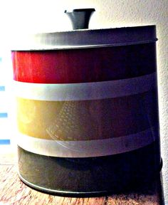 Retro red, yellow, and green vintage tin metal  canister for dry goods and food. Great for cookies, picnics, and camping.