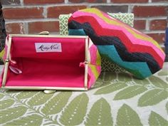 Custom Clutch for DeluxeLife+Style -- What's the recipe for a great handbag? Add 1 part Betsey Johnson for fun, another part Coach for timeless design and top it all off with a whole lot of Kansas City. What you'll get is this beautiful, hand-made, custom clutch from Maddy Nash. The editors at DeluxeLife+Style chose from Maddy Nash's exquisite selection of sturdy interior and exterior fabrics and came up with three color combinations to fall for. 10% of all purchases go to charity.