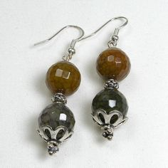 """Handmade gemstone agate earrings feature semi-precious, faceted agate gemstones, fishhook-style earwires, sterling silver accent beads and caps. 2 1/2"""" in length. Add a necklace, pendant and bracelet"""