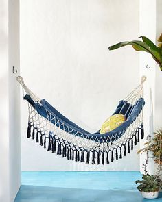 Having a great hammock or a swing in your backyard is cool, but putting one up inside your home? Now that's a refreshing way to give a new meaning to hanging out. There's something extra cozy (not to mention totally chic) about indoor hammocks and hanging chairs—it's like you can just curl up and float on cloud nine right there in your living room. No matter what your style is, from rainbows to macramé, there's a hanging retreat for everyone on this list. Indoor Swing, Indoor Hammock, Hammock Chair, Hammocks, Cozy Family Rooms, Hanging Out, Hanging Chairs, Anthropologie Uk, What's Your Style