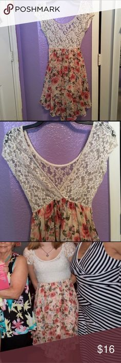 Lace Floral Dress Beautiful dress perfect for weddings, parties, or other special occasions. Lace see-through top and flowy floral skirt with built in slip. The back is a v-neck, shown in second pic. A few stains on the slip but not visible from the outside. Used but in good condition. PLEASE READ THE ENTIRE DESCRIPTION BEFORE PURCHASING! 🚫 NO TRADES. NO HOLDS. NO MERC@RI 🚫📩 I only respond to offers made through the offer button 🙋🏼Questions? Just ask! Serious inquiries only please…