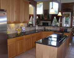 Tan brown countertops with light cabinets kitchen stuff for Granite remnants los angeles ca