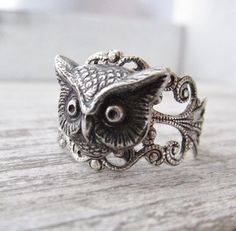 Hey, I found this really awesome Etsy listing at https://www.etsy.com/listing/208902601/owl-ring-silver-adjustable-owl-head-ring