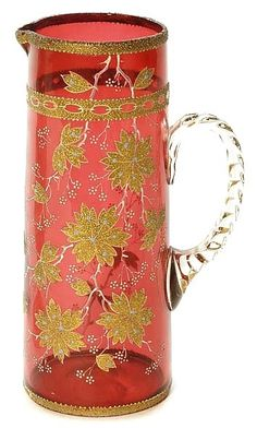 A Moser cranberry tankard pitcher, cylindrical form in translicent cranberry decorated with white flowering branches of gold coralene accented with blue spots, applied crystal handle. Carafe, Steuben Glass, Vases, Floral Vintage, Cranberry Glass, Crystal Glassware, Ludwig, Glass Pitchers, Bottle Vase