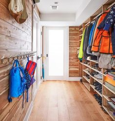 The homeowners created a red cedar–lined storage space in the basement for off-season outerwear, sports gear, and schoolbags. Light pours in from a window behind the frosted glass door. Bench With Storage, Storage Bins, Storage Spaces, Storage Ideas, Shoe Storage Solutions, Entry Way Design, Room Additions, Closet Bedroom, Home Reno