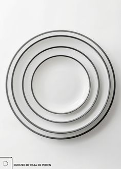 """The finest Limoges porcelain with a hand-painted, brushed matte black rim.   Charger Plate (12"""") Dinner Plate (10.5"""") Salad/Dessert Plate (8.25"""")  Bread Plate (6.25"""")  Soup/Pasta Bowl (7.5"""") Cup/Saucer Duo Demitasse/Saucer Duo"""