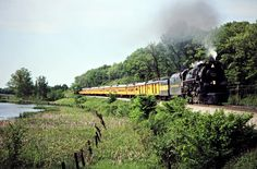 https://flic.kr/p/HswDRv | C&O, Clyde, Michigan, 1981 | Southbound Chesapeake and Ohio Railway passenger excursion train led by stream locomotive no. 614 in Clyde, Michigan, on May 30, 1981. Photograph by John F. Bjorklund, © 2015, Center for Railroad Photography and Art. Bjorklund-35-03-20