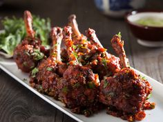 DRUMS OF HEAVEN RECIPE - A slight twist to your ordinary chicken lollipop, this chicken wings fried and tossed in schezwan sauce is a famous appetizer. The sauce make the chicken more succulent.