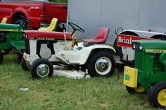 Red and white John Deere 110 Patio garden tractor.