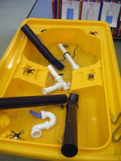 Incy wincy inspired water play.....Drainpipes and assorted pretend spiders
