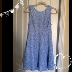 Dress from Forever 21 This is a light blue dress with small, white polka dots. It is A-line style, & it has a zipper closure back. There are two belt loops for a belt. Never worn. Size Medium Forever 21 Dresses