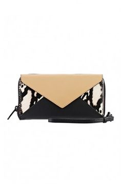 The python print Zip Wallet ($195) from Loeffler Randall will add a pop to any outfit. #wallet #loefflerrandall