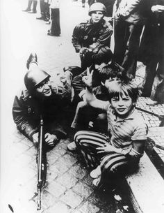 """1974 Carnation Revolution - A Portuguese boy poses with soldiers of the left-wing revolutionary Armed Forces Movement (Movimento das Forças Armadas) as they mobilize to overthrow the Fascist """"Estado Novo"""" regime. Great Photos, Old Photos, History Of Portugal, 25 Avril, Portuguese Culture, Ap World History, Fidel Castro, Photography Exhibition, Portugal Travel"""