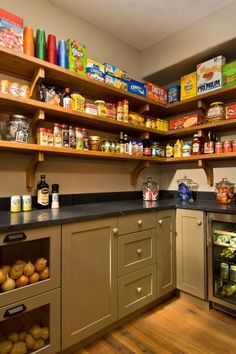 Walk in pantry. Love this idea. Perfect reuse of the old laundry room connected to the kitchen. Note the glass doors in the onion bins. Fantasy pantry!