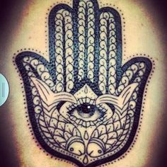 (a hasma hand tattoo)   This is a funny my mom just bought a dress with this design on it hahah