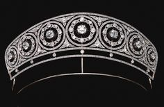 Diamond tiara, circa as a series of seven graduated circles millegrain-set with rose stones, each inset with a rose and circular-cut diamond wreath, to a cushion-shaped diamond center set. Royal Crowns, Royal Tiaras, Tiaras And Crowns, Diamond Tiara, Diamond Cuts, Royal Jewelry, Fine Jewelry, Antique Jewelry, Vintage Jewelry